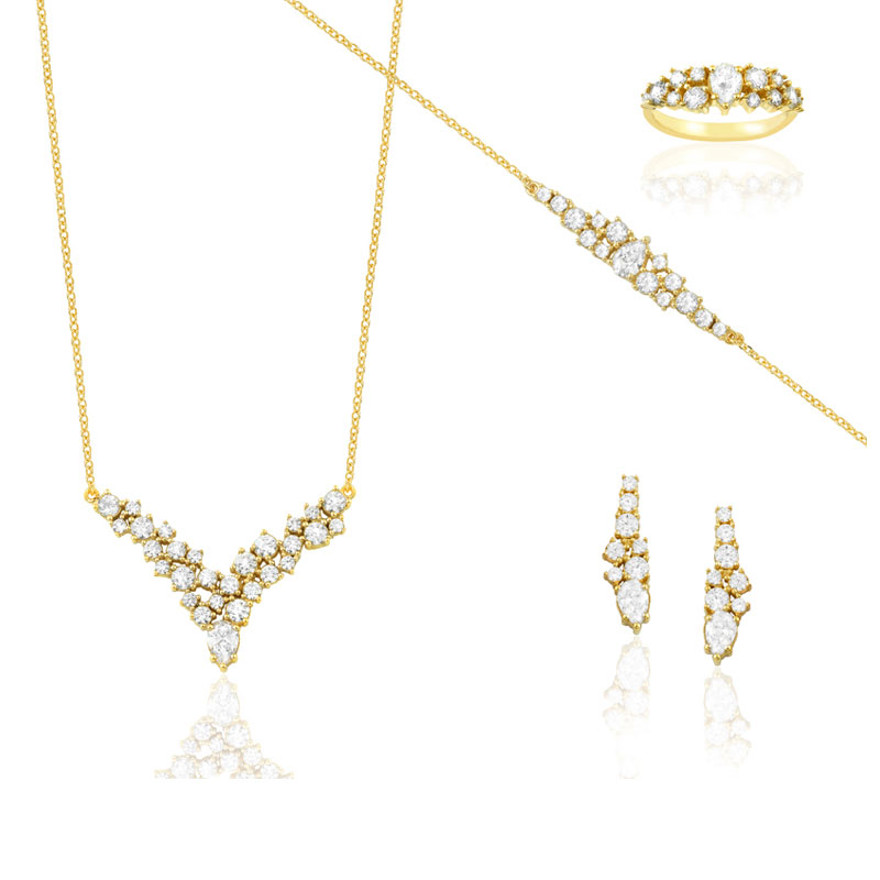YELLOW GOLD V SET WITH WHITE ZIRCONS